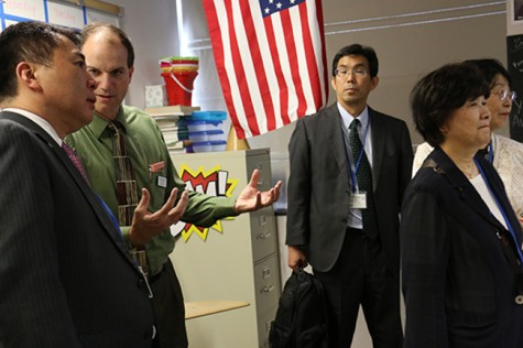 Principal Mark Newell speaks with a visitor from Columbus' sister city: Miyoshi, Japan.