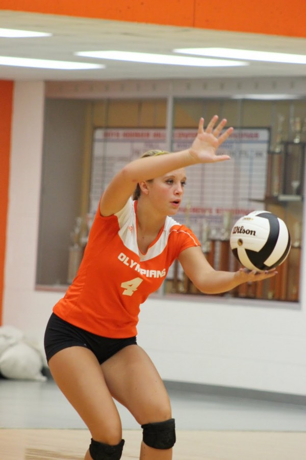 Senior Lauren Baugh prepares to serve during the 2014 volleyball season.