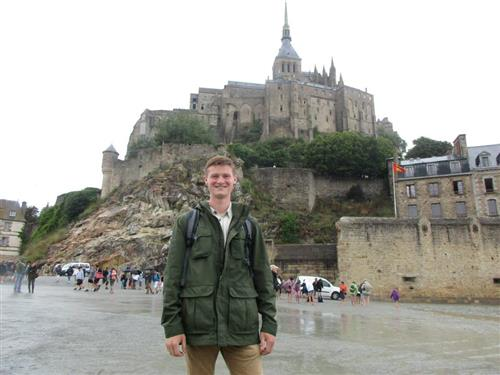 Senior Jacob Harpring stands in front of the Mont Saint-Michel during his trip to France this past summer.