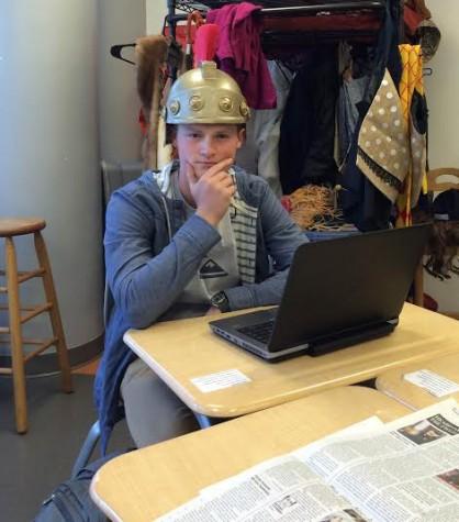 Senior Jacob Harpring, hard at work during Newspaper class.