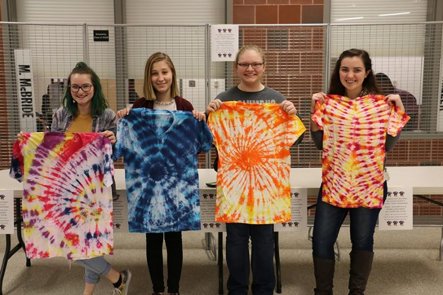 Students Madi Allen, Marselle Barbieri, Kailyn Hilycord and Nia Pontius display shirts that can be bought during 5A and 5B.