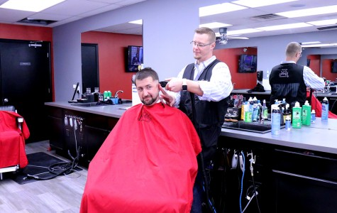 East graduate owns and operates local barbershop