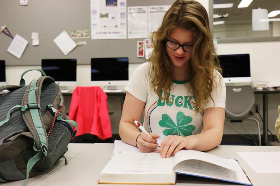 Senior Maelyn Kiser works on homework before school.