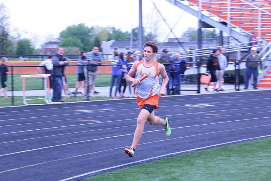 Junior Paul Bean runs his leg of the 4x800 relay during the North vs. East track meet on Thursday.