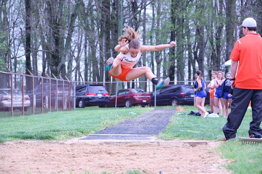 Junior Kayla Gastineau competes in the long jump event during the North vs. East track meet on Thursday.