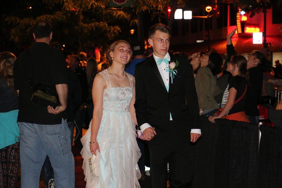 Junior Mila Lipinski and senior Ian Pittman walk into Prom.