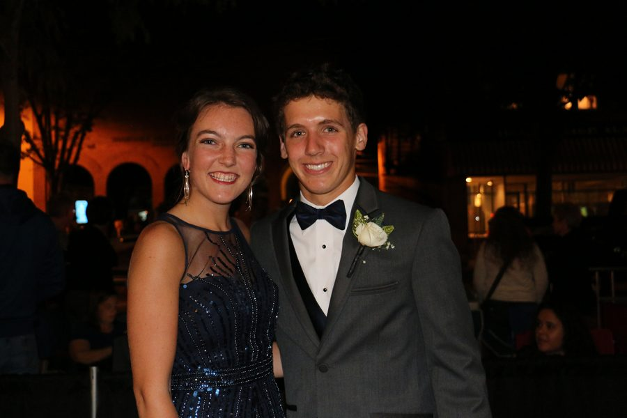 Senior Maddie Lyons and junior Paul Bean smile before entering the Commons.