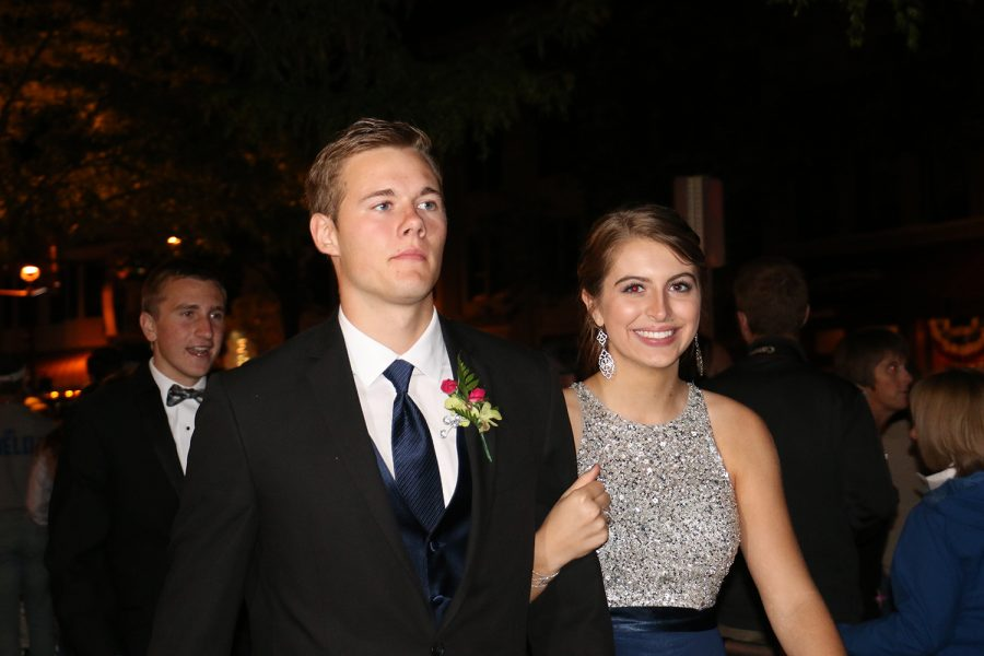 Junior Reilly Jones and her date walk in to the Columbus Prom.