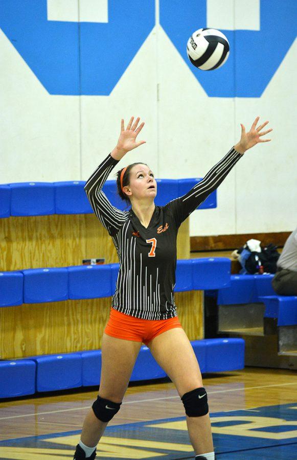 East senior Bailey Western serves the ball.