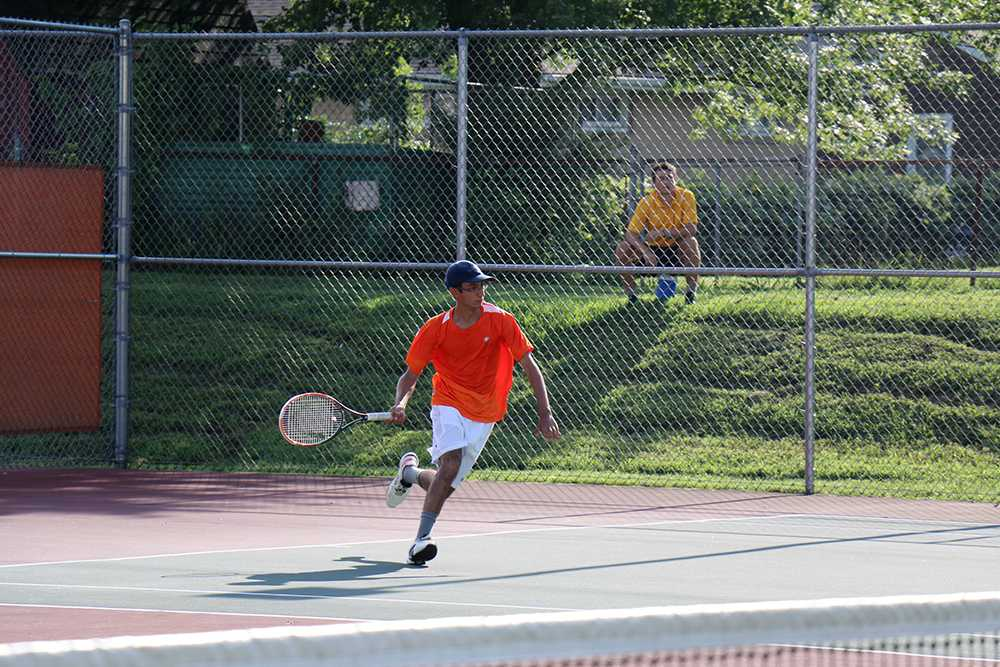 Senior Neeraj Pandita hits the ball against North.