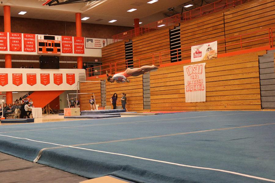 Sophomore Abby Lewis competes during her floor routine.