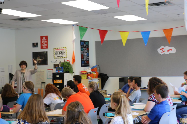 Freshman listen to English teacher Nevie Dewhirst teach.