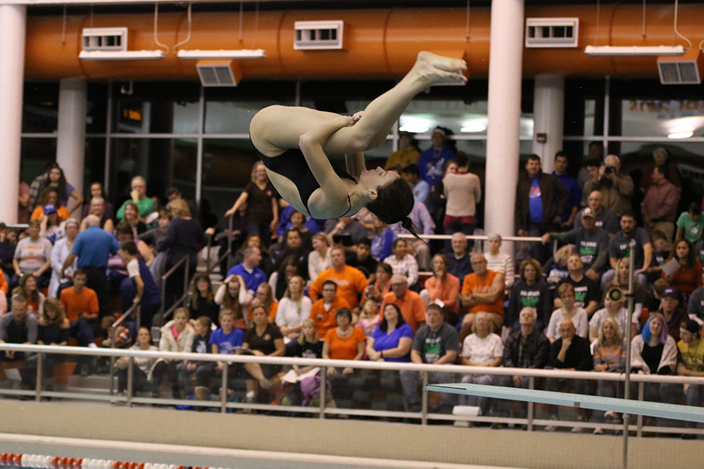 Senior Maggie Gregory performs a dive.