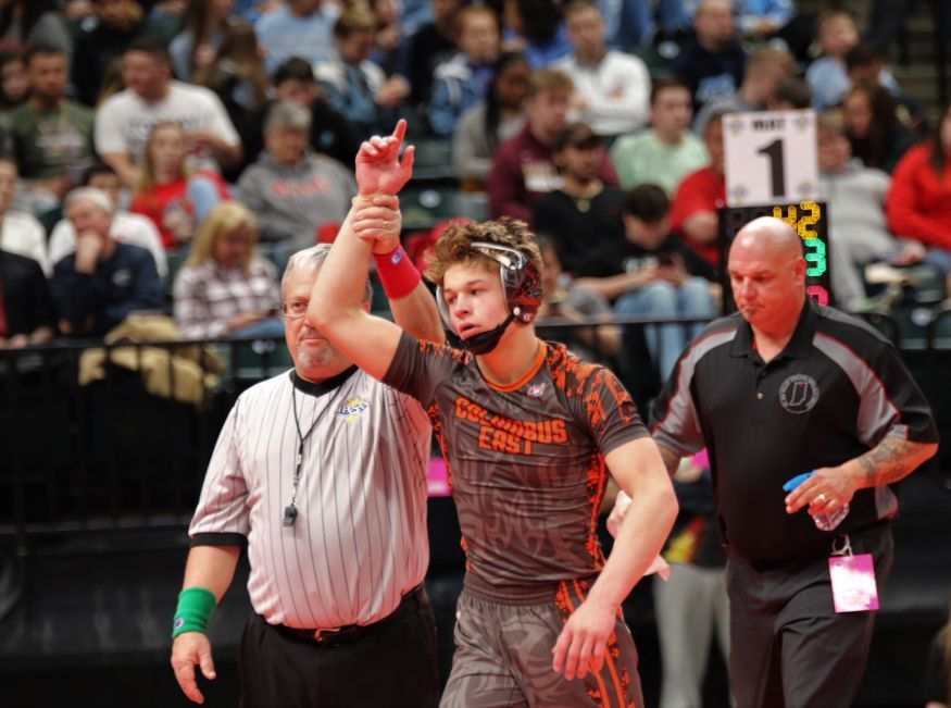 The+referee+raises+the+arm+of+East%27s+Dawson+Combest%2C+who+defeated+Beech+Grove%27s+Bailey+Moore+in+a+5-3+decision+at+138+pounds.