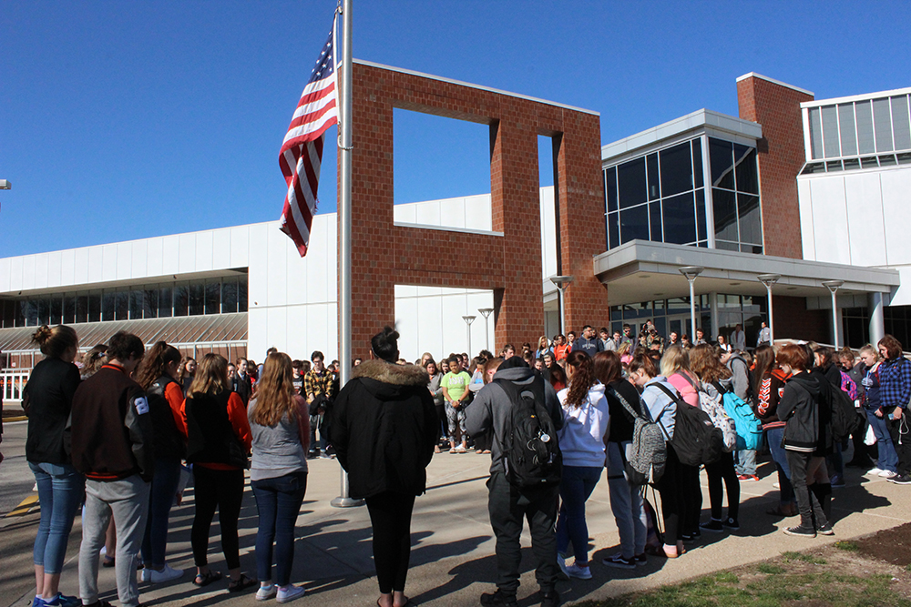 Students gather outside of school for the walkout.
