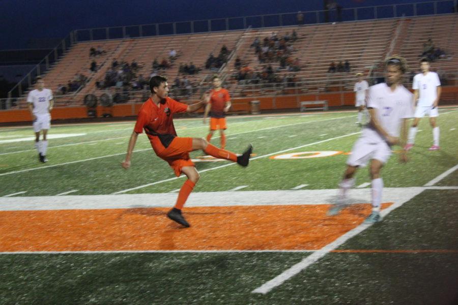 Sophomore Logan Cline crosses the ball into the box.