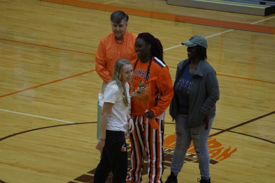 Senior+Beyonce+Coleman-Turner+receives+laughs+with+her+teammate+junior+Whitley+Rankin.