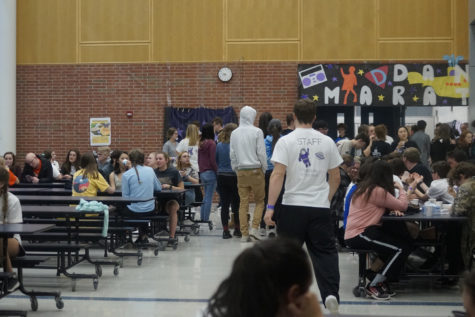 Students hang out in the cafeteria during the event.