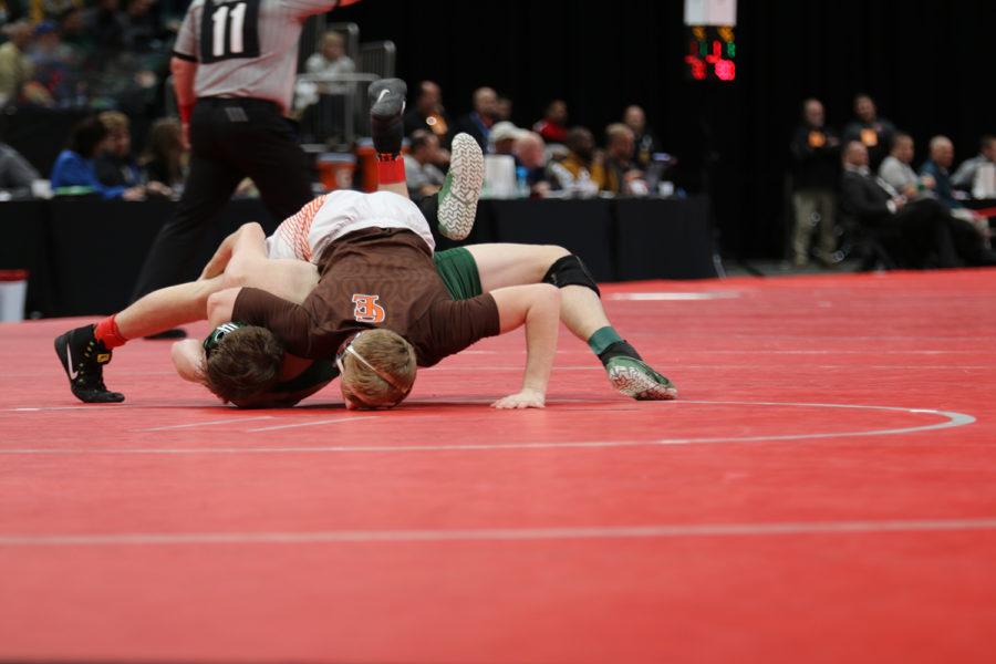 Senior Cayden Rooks turns his opponent.