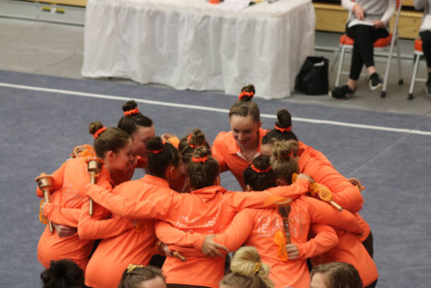 The team huddling up before the meet starts.