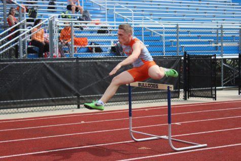 Senior Jared Baker races through the 300 hurdles.