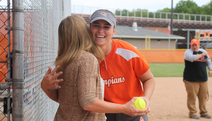 Senior third baseman Brooke Valles hugs her mentor.