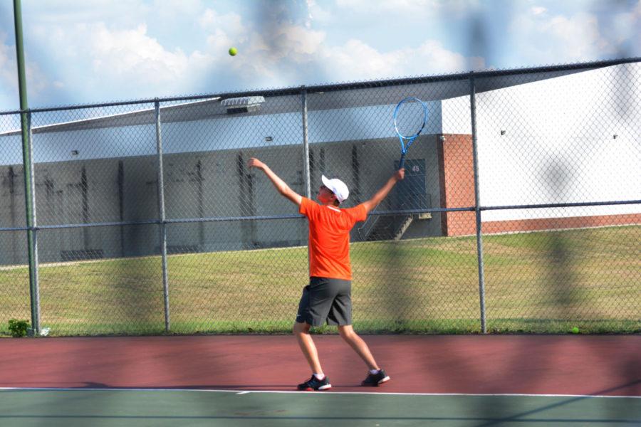 Freshman Matthew Degner serves the ball.