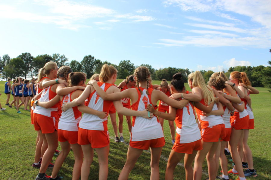The girls cross country team warming up with their cheer song.