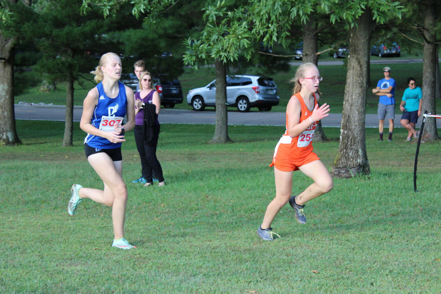 Freshman+Riley+Carothers+racing+a+runner+from+North.