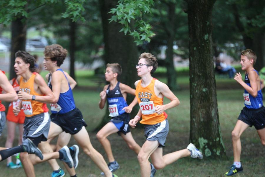 Senior+Matthew+Novreske+trying+to+pass+a+North+runner.