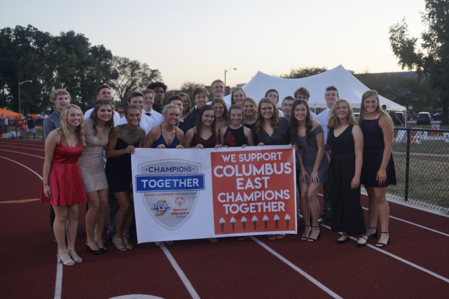 The homecoming court holds up a banner in support of Champions Together, a partnership between Indiana High School Athletic Association and Special Olympics Indiana.