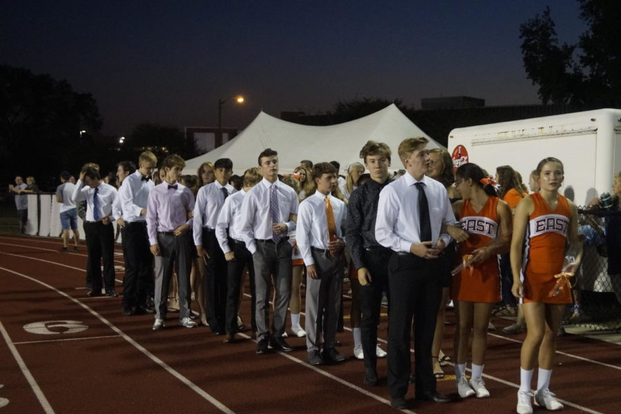 The homecoming court waits to walk in front of the crowd.