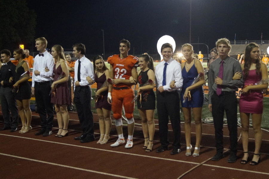 The junior homecoming court wait for the winners to be announced.