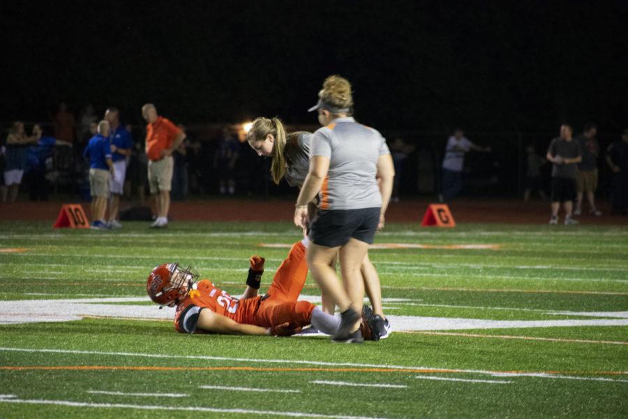 Senior Lance Greiwe injures his leg.