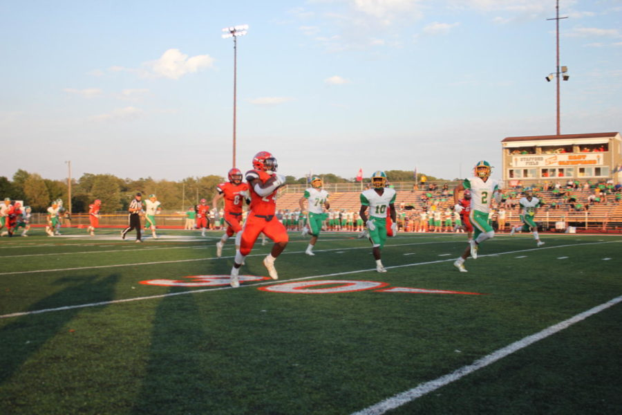 Junior Mark McDonald rushes for a long touchdown to kickoff the game.