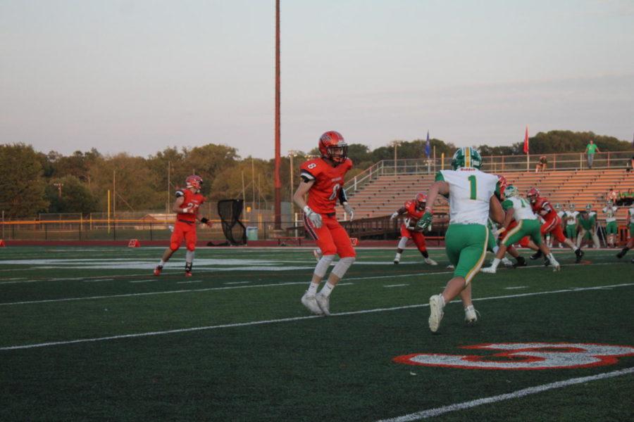 Senior Zander Gentry blocks down field as the Junior Mark McDonald runs the ball.