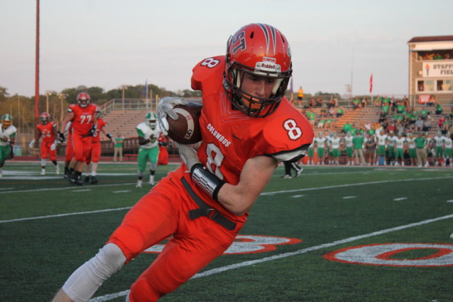 Senior Zander Gentry runs with the ball after it is punted.