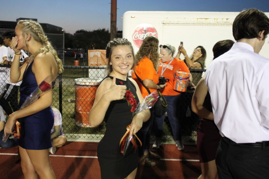 Junior Ally Piatowski gives a thumbs up before walking onto the track.
