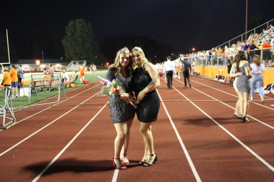 Senior Abby Meier and senior Sam Hutcheson take a photo together during the game.