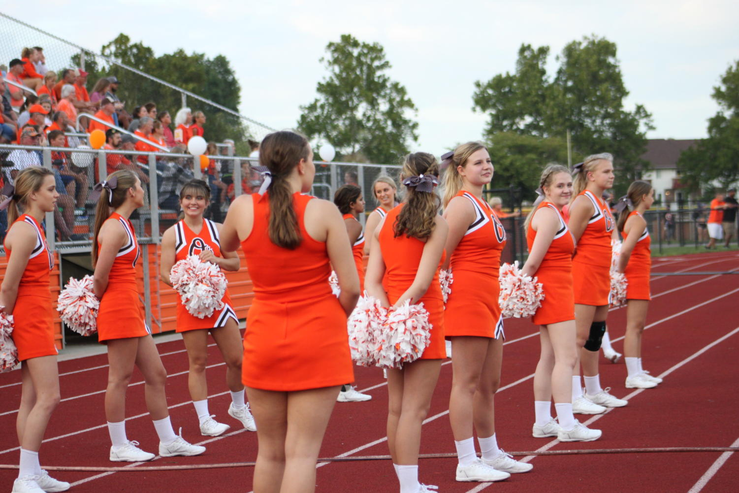 Cheerleaders+line+up+to+watch+the+game.
