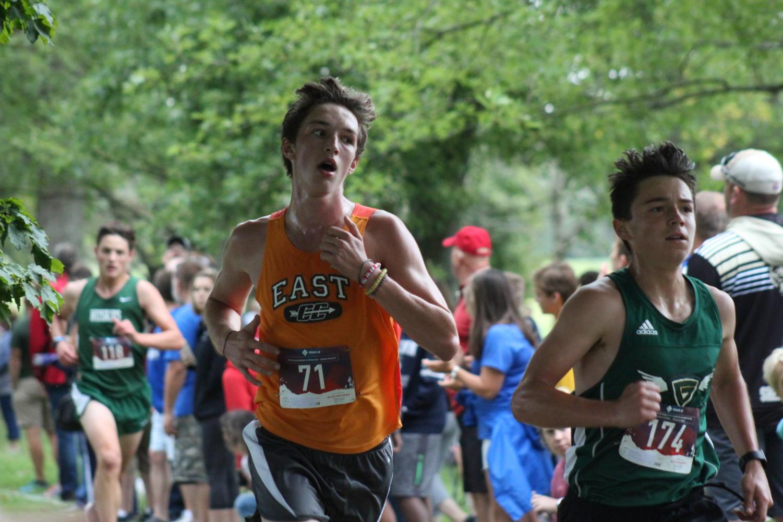 Senior+Ryan+Sadtler+looks+to+pass+the+runner+next+to+him.