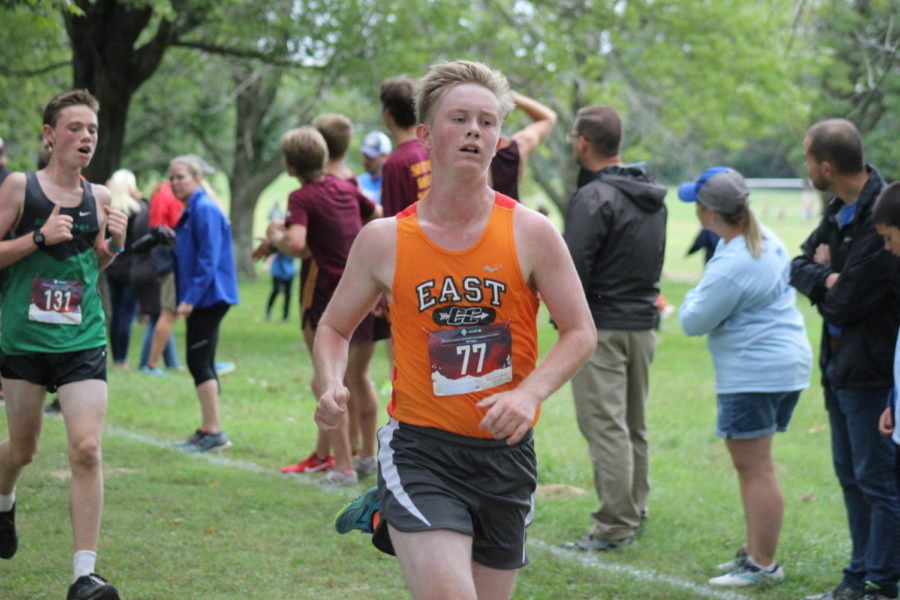 Junior Kaden Wise running towards the finish line.