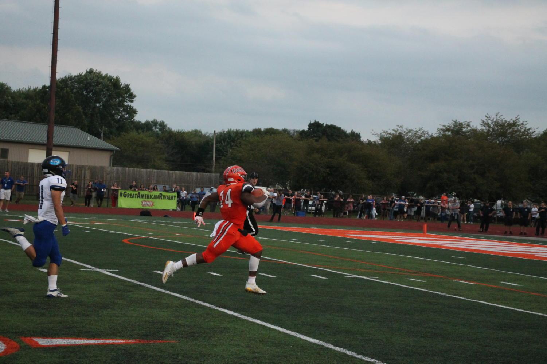 Junior+Mark+McDonald+rushing+for+touchdown.