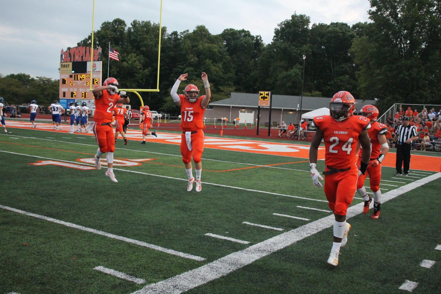 %28Left+to+right%29%3A+Junior+Malachi+Parks%2C+senior+Cole+Gilley+and+junior+Mark+McDonald+celebrate+the+touchdown.
