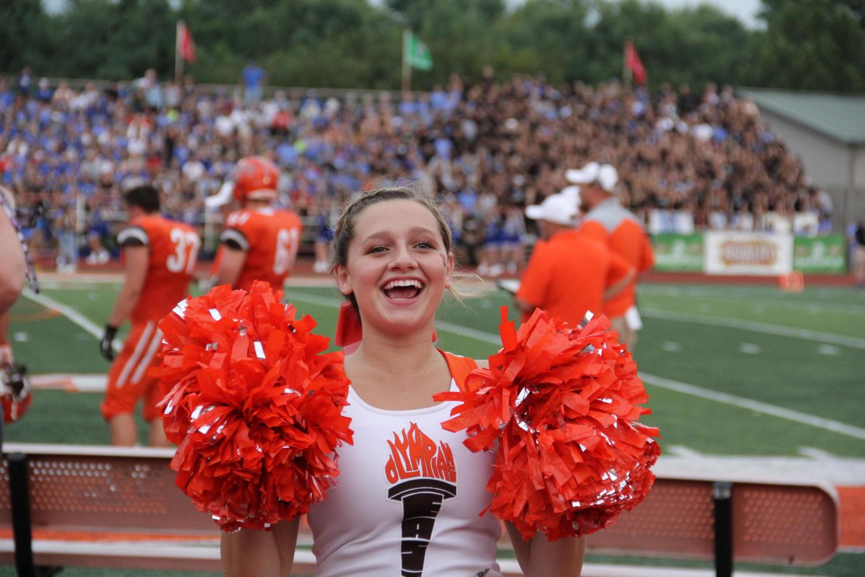 Sophomore+Savannah+Wells+cheering+on+the+home+side.