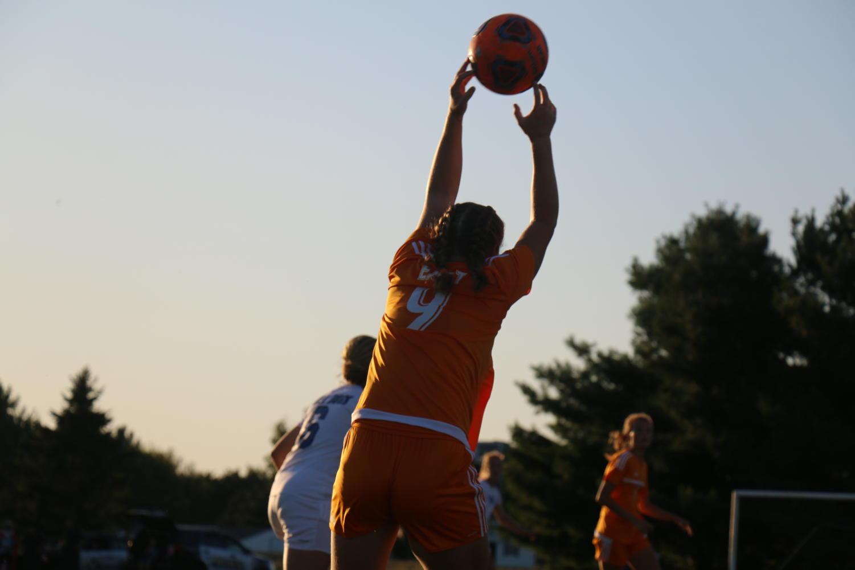 Junior Alana Dwenger throws the ball in.