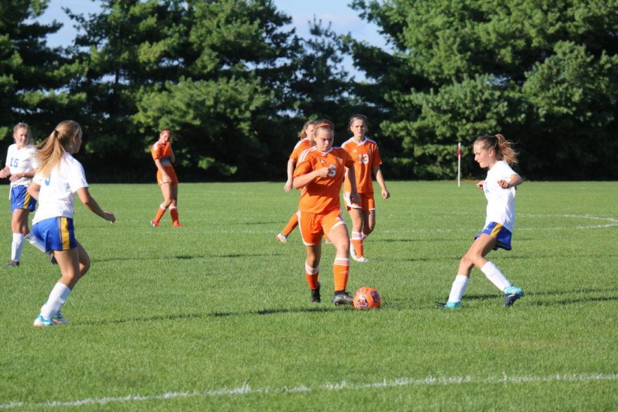 Freshman+Sydney+Berkemier+runs+across+the+field.
