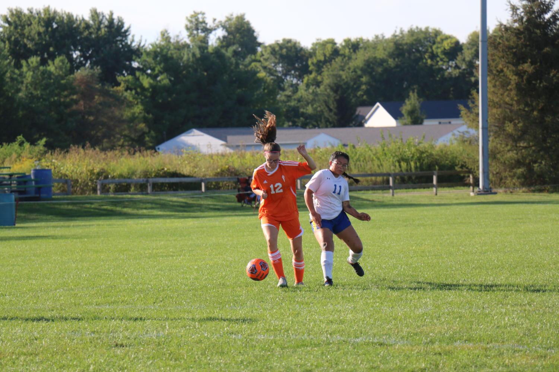 Freshman Cami Warren dribbles around defender.