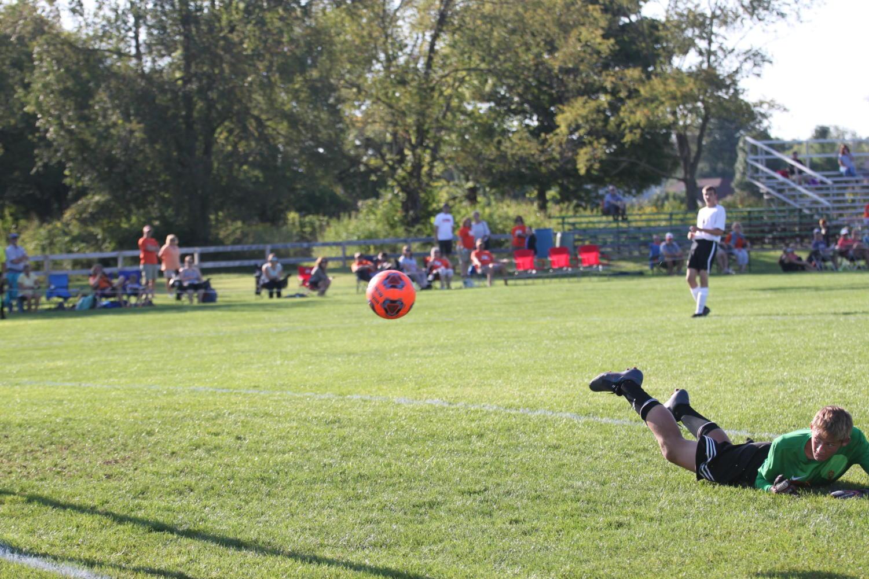 Sophomore+Pete+Coriden+dives+for+a+shot.