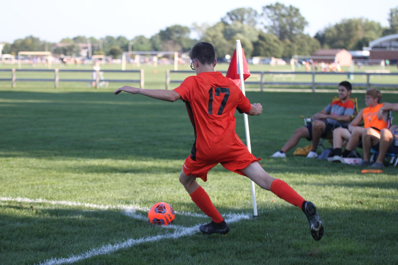 Freshman+Max+Nash+takes+a+corner+kick.